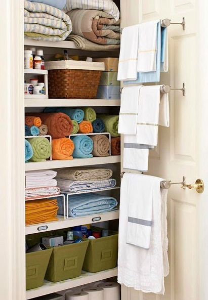use towel rods on the inside of your linen closet  door for more storage via BHG