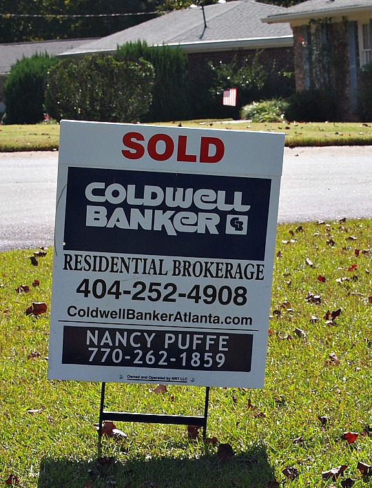 real estate sign that says sold