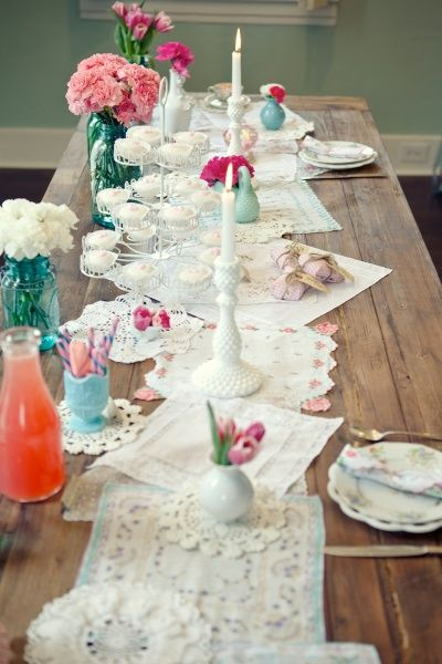 Vintage hankies and doilies used as a beautiful tablerunner