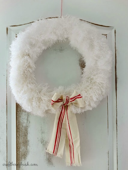 10 Amazing Dollar Store Christmas Crafts like this  pretty wreath from Craftberry Bush