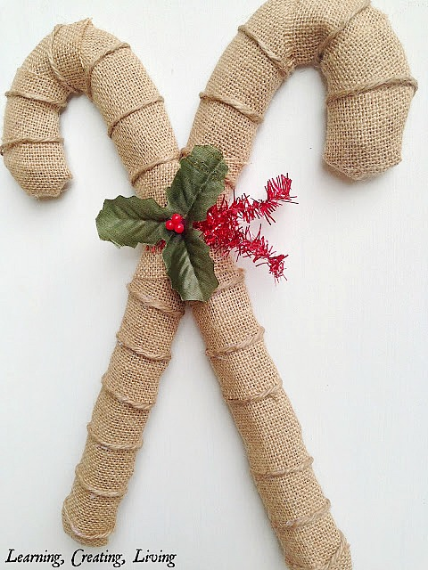 10 Amazing DIY Dollar Store Christmas Decorations like this burlap candy cane