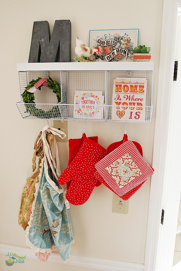 Pretty place to hang your aprons and pot holders. Great way to increase storage if you don't have lots of drawers in you kitchen.