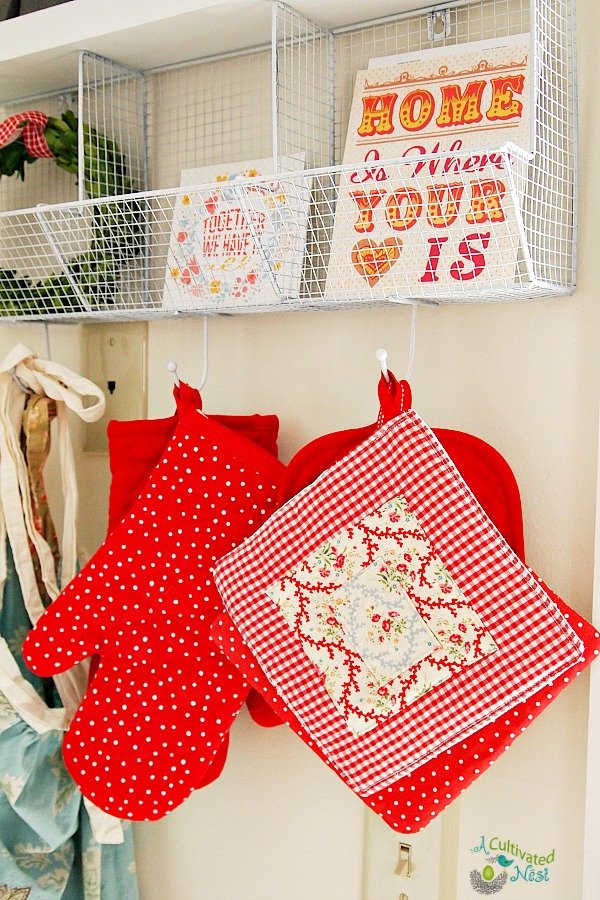 Cute kitchen shelf with hooks for pot holders and aprons