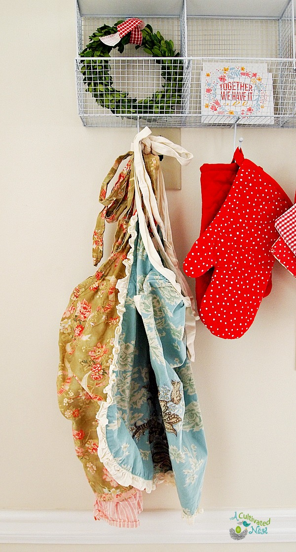 A pretty way to provide some extra storage for potholder and aprons.