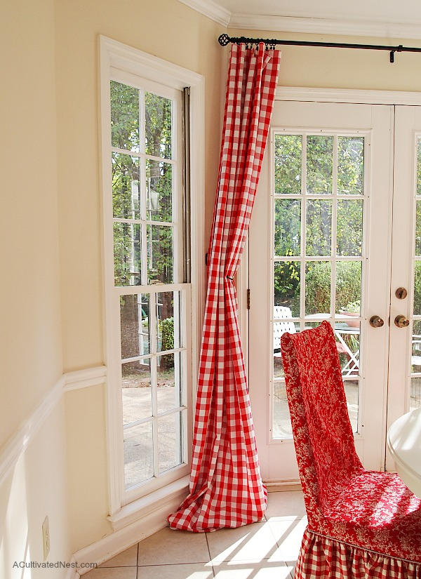 Inexpensive curtain idea - red buffalo check curtains are really tablecloths