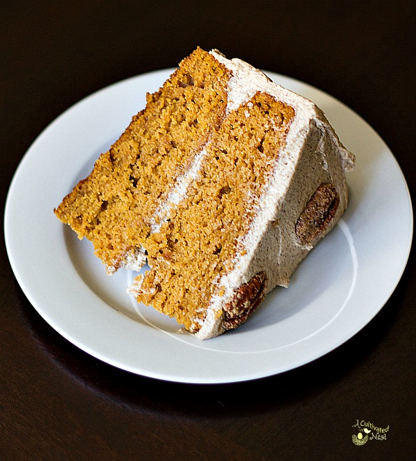 slice of pumpkin cake with brown sugar cinnamon buttercream frosting made from scratch
