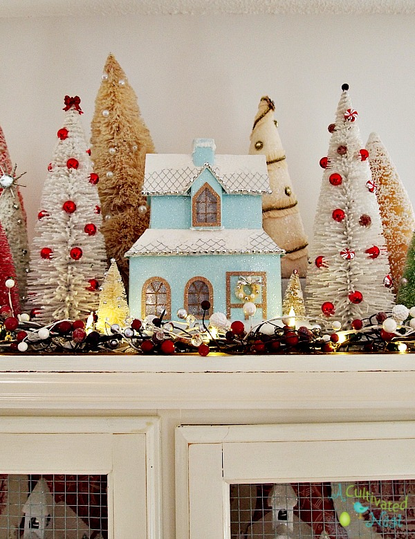 Pretty glittery Christmas china cabinet decorations.