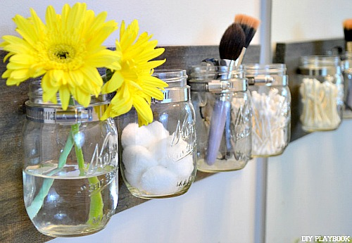 Get Organized With Jars - like this DIY All-Purpose Mason Jar Organizer from DIY Playbook