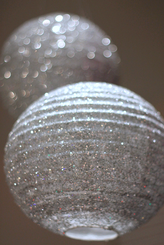 7 Festive and Frugal Ways to Decorate for New Year's Eve - DIY sparkle lanters for New Year's Eve from The Chickabug Blog