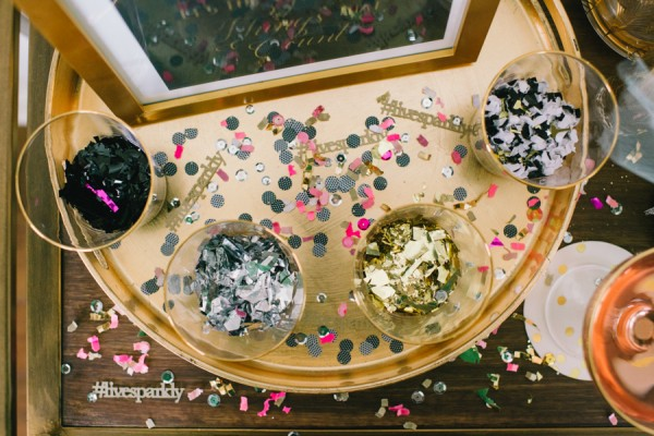 7 Festive and Frugal Ways to Decorate for New Year's Eve - use confetti on tables for New Year's Eve