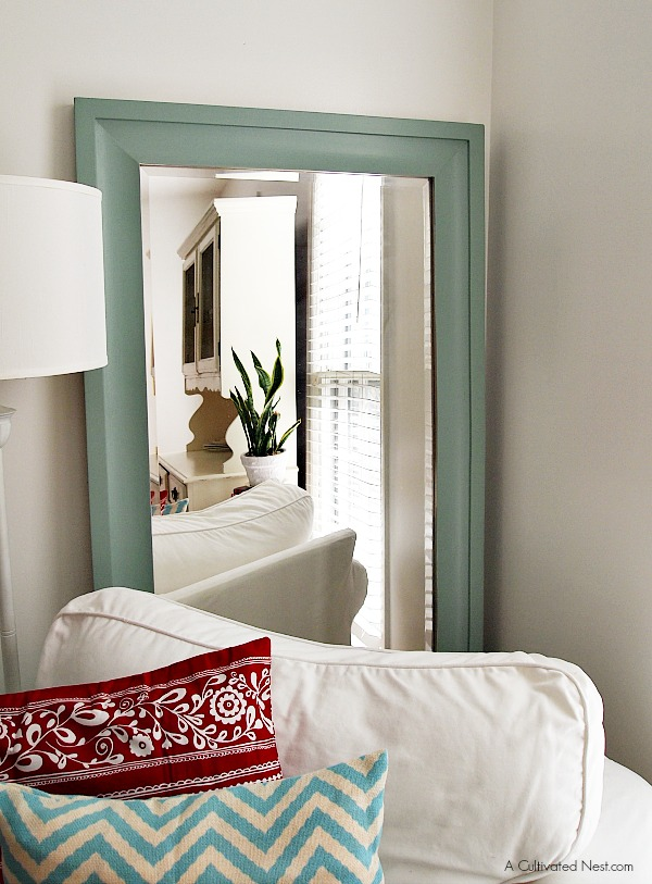 large wall mirror behind white Ektorp chair