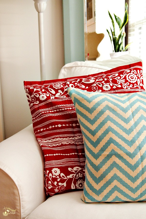 Cute color combination! Red and soft aqua pillows on a white Ektorp Chair