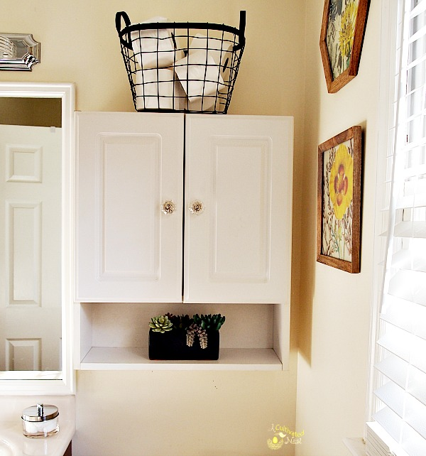 Use a wire basket to hold extra bathroom supplies like TP