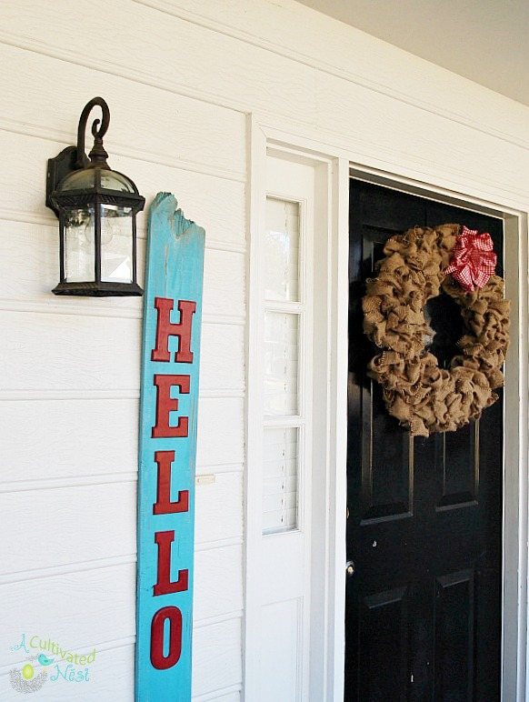 "Easy to make DIY reclaimed wood sign that says ""Hello"""