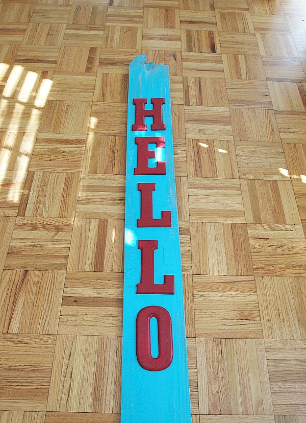 Lay out your letters on your piece of wood before gluing down.