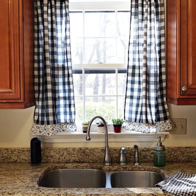 Black buffalo check kitchen curtains made from thrift store drapes - budget decorating idea!
