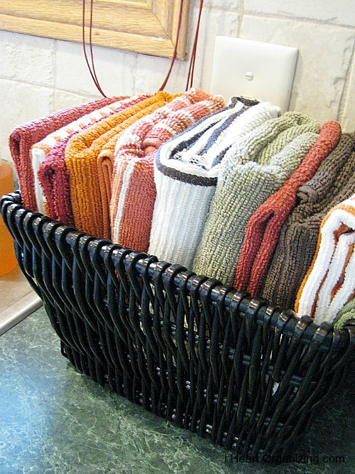 10 Ways To Organize With Baskets | organize your dish towels in a pretty basket on your kitchen countertop