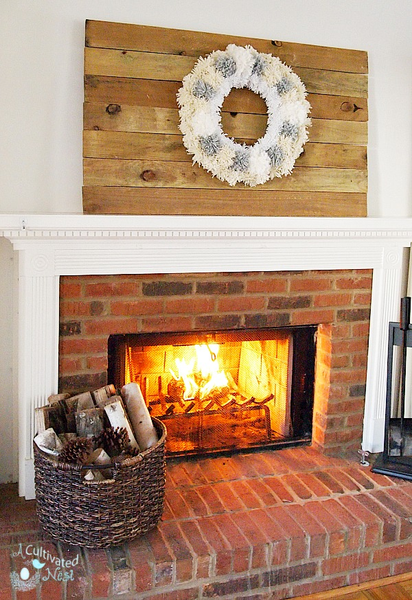 DIY Reclaimed wood wall art with pom pom wreath