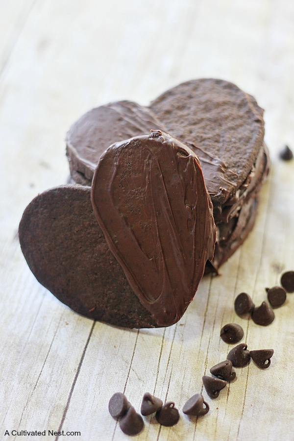 Delicious double chocolate shortbread cookies - Shortbread is pretty good just as is but making it chocolate AND adding an extra layer of chocolate just pushes the decadence level right over the top! Use a heart cookie cutter to make this a Valentine's Day Treat!