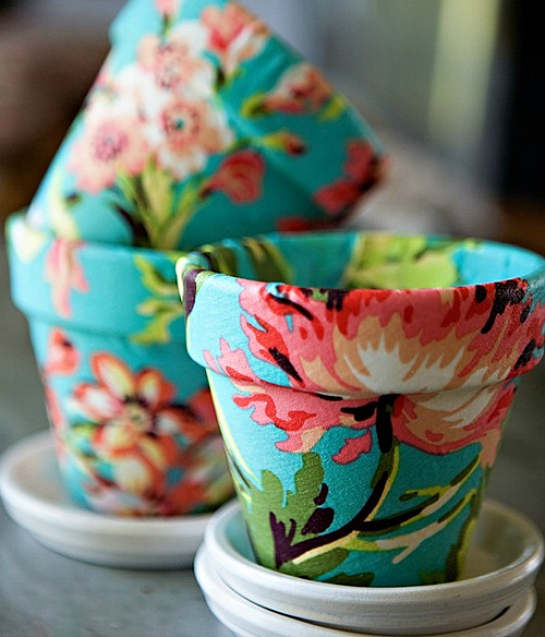 10 Creative DIY Planter Makeovers - spruce up your old plain pots with these great ideas! Like this floral fabric covered pot.