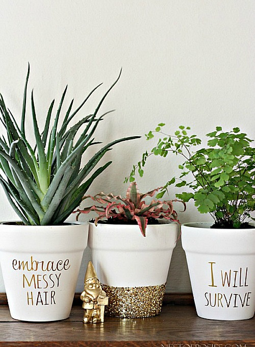 10 Creative DIY Planter Makeovers like these DIY Gold Foil Lettered Pots