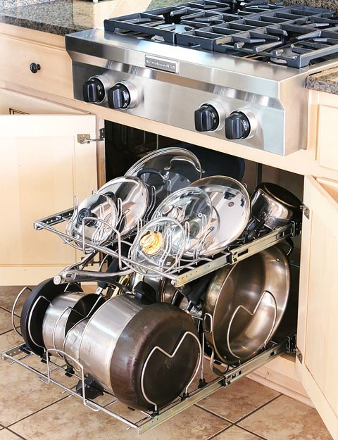 10 Awesome Pots and Pans Organizing Solutions- Tired of your pots and pans always being unorganized? You need to check out these handy tips for organizing pots and pans! | #kitchenOrganization #organizingTips #organizationIdeas #organize #ACultivatedNest