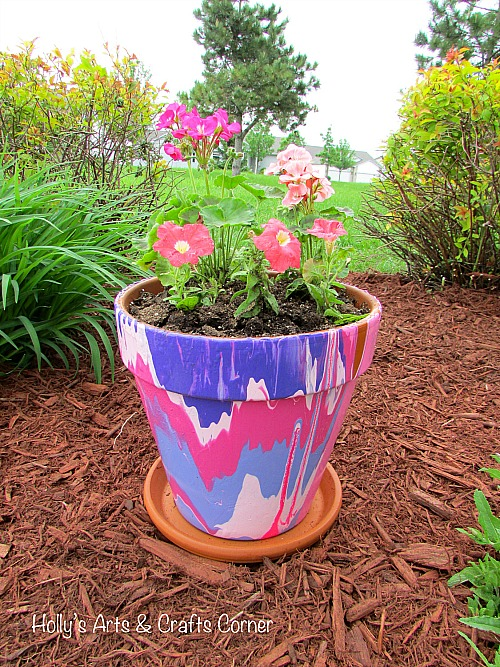 10 Creative DIY Planter Makeover Ideas: multi-color-paint-pour-diy-drip-pot