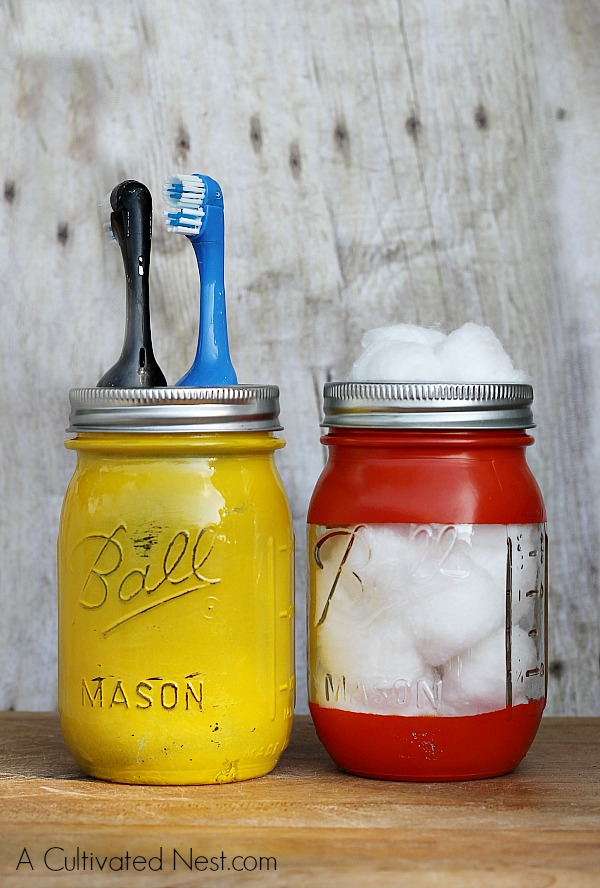 Diy painted mason jar bathroom organizer for Small bathroom jars