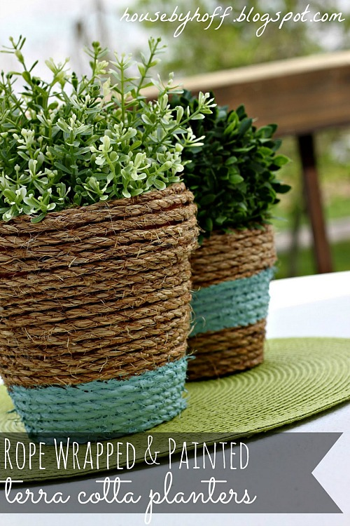10 Creative DIY planter Makeovers like these rope wrapped and painted terra cotta pots.