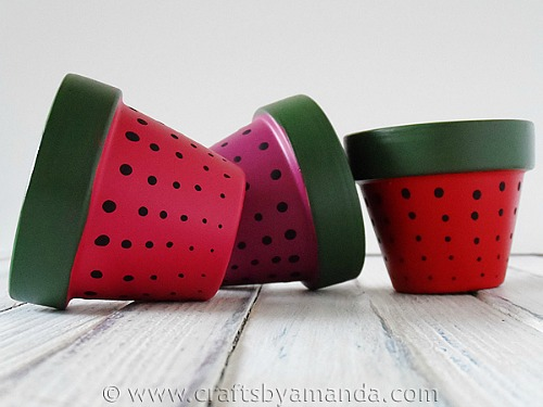 10 Creative DIY Planter Makeovers - spruce up your old plain pots with these great ideas! Like these strawberry-painted-terra-cotta-pots