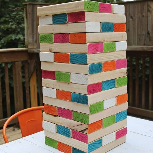 Giant Backyard Jenga- Here are 10 inexpensive summer outdoor activities that will keep the kids or grandkids occupied all summer long! Definitely give these a try this summer! | #kidsActivities #frugalLiving #summerActivities #summerKidsActivities #ACultivatedNest