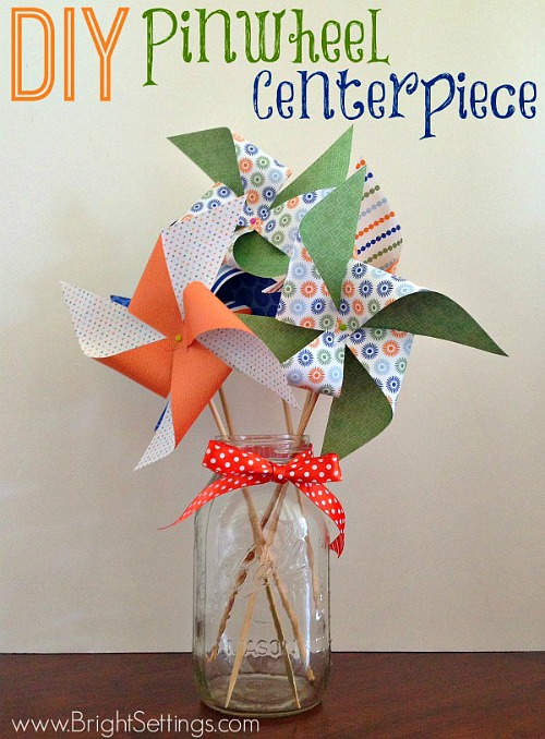 10 Summer Mason Jar Craft Ideas like this DIY pinwheel Mason jar centerpiece tutorial