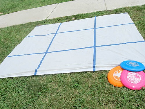 10 Summer Activities for Kids - play outdoor tic-tac-toe with dollar store frisbees