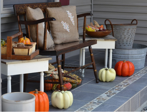 Vintage Front Porch- Unsure how to decorate your front porch for autumn? Take a look at these 15 fabulous fall front porch ideas and be inspired! | #fall #porchDecor #decorating #fallDecor #ACultivatedNest
