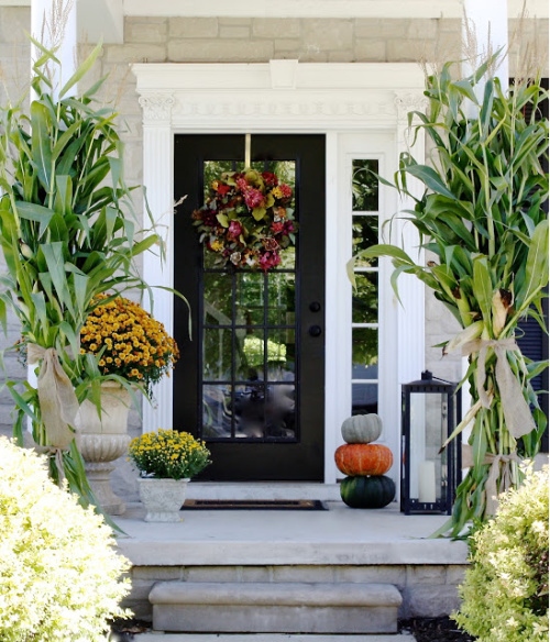 Charming Fall Porch- Unsure how to decorate your front porch for autumn? Take a look at these 15 fabulous fall front porch ideas and be inspired! | #fall #porchDecor #decorating #fallDecor #ACultivatedNest