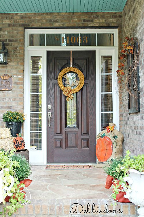 Art Pumpkins Fall Front Porch- Unsure how to decorate your front porch for autumn? Take a look at these 15 fabulous fall front porch ideas and be inspired! | #fall #porchDecor #decorating #fallDecor #ACultivatedNest