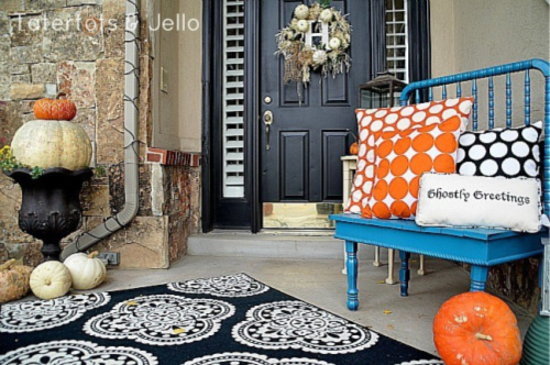 Polka Dot Front Porch- Unsure how to decorate your front porch for autumn? Take a look at these 15 fabulous fall front porch ideas and be inspired! | #fall #porchDecor #decorating #fallDecor #ACultivatedNest