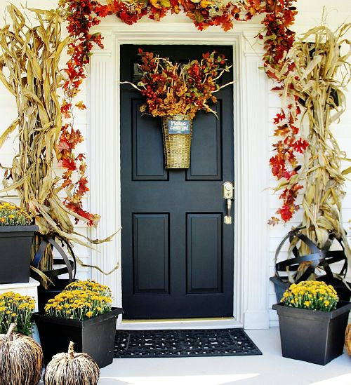 Farmhouse Door Fall Front Porch- Unsure how to decorate your front porch for autumn? Take a look at these 15 fabulous fall front porch ideas and be inspired! | #fall #porchDecor #decorating #fallDecor #ACultivatedNest