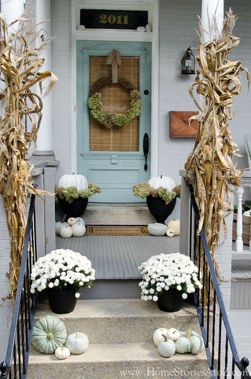 White and Blue Fall Front Porch- Unsure how to decorate your front porch for autumn? Take a look at these 15 fabulous fall front porch ideas and be inspired! | #fall #porchDecor #decorating #fallDecor #ACultivatedNest