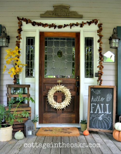 Wide Fall Front Porch- Unsure how to decorate your front porch for autumn? Take a look at these 15 fabulous fall front porch ideas and be inspired! | #fall #porchDecor #decorating #fallDecor #ACultivatedNest