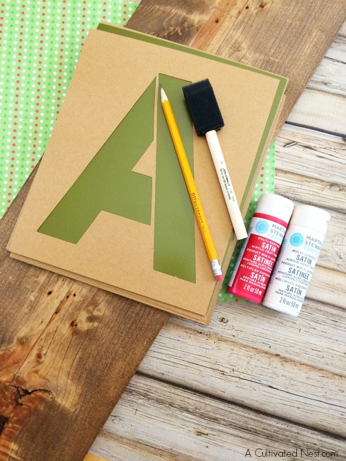 """Be Merry"" DIY Christmas Sign- Here's a festive way to welcome your guests this holiday season! This is an easy (and pretty) DIY Christmas decorating project for your porch! 