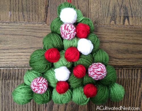 Want to decorate your home with more Christmas tree shaped decorations? Then you've got to make this adorable DIY Christmas yarn tree!