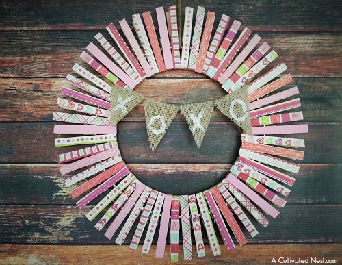 DIY Valentine's Day Clothespin Wreath- Want to make a different kind of Valentine's wreath this year? Then you have to make this adorable DIY Valentine's Day clothespin wreath! Use differently themed scrapbook paper and you can make a fun wreath for any season! | scrapbook paper scraps, love, hearts, frugal decor, #wreath #ValentinesDay #DIY #craft