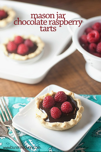 Mason Jar Chocolate Raspberry Tarts- If you've never tried making Mason jar lid desserts, then you're missing out! They're delicious, and the perfect size for party treats!