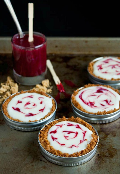 White Chocolate Raspberry Mini Tarts- If you've never tried making Mason jar lid desserts, then you're missing out! They're delicious, and the perfect size for party treats!
