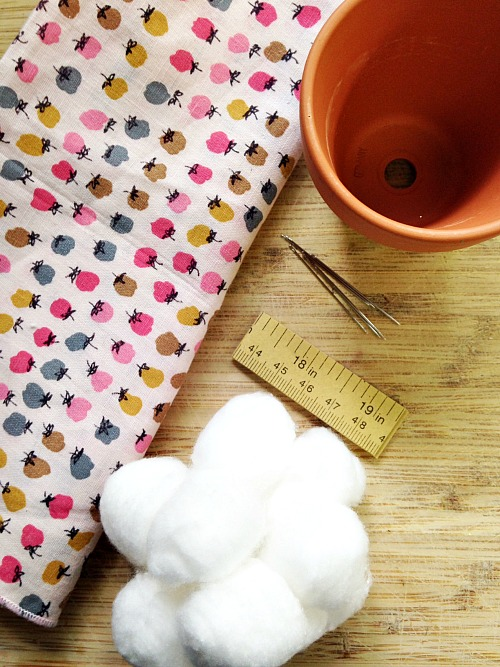 Want a stylish yet organized sewing area? Keep your pins and needles organized with this cute flower pot pin cushion craft!