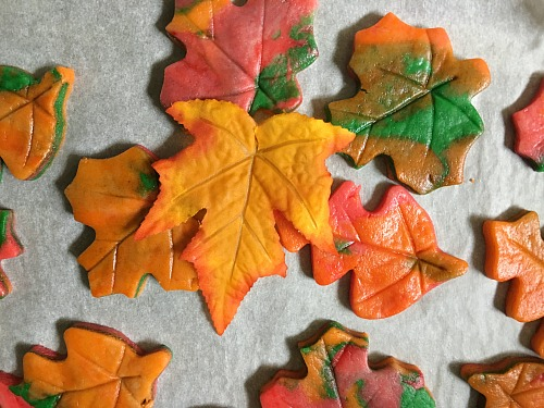 These colorful fall leaf cookies are perfect for parties, or just as a fun fall dessert! They're also really easy to make and kids love to help with them!