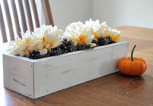 You don't need any fancy paint or special skills to make this DIY rustic planter box! This makes a great table centerpiece or piece of mantel decor!
