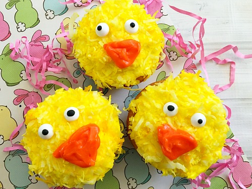 Cute Spring Chick Cupcakes- Use your favorite boxed cake mix to quickly create cupcakes that you can decorate and turn into cute spring chick cupcakes! These make a great Easter dessert! | easy recipe, Easter treat, spring food, adorable, silly, funny, baking, box mix recipe, animal themed cupcakes, yellow, orange