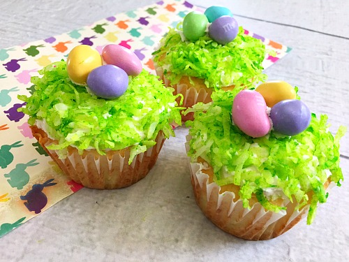 Nest Easter Cupcakes- If you want a quick, simple, but beautiful dessert to serve this Easter, you need to make these adorable nest Easter cupcakes! | easy recipe, quick recipe, boxed mix baking, Easter dessert, spring treat, eggs, grass, cupcake decorating ideas
